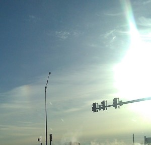 The sundog can be seen just to the left of the light pole.
